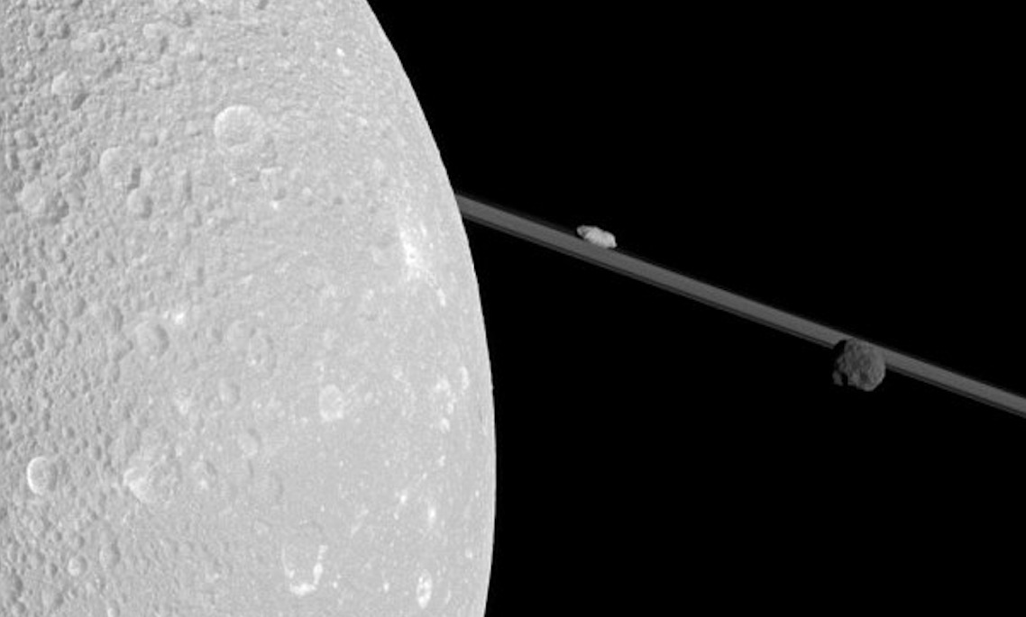Dione with 2 little moons from Cassini
