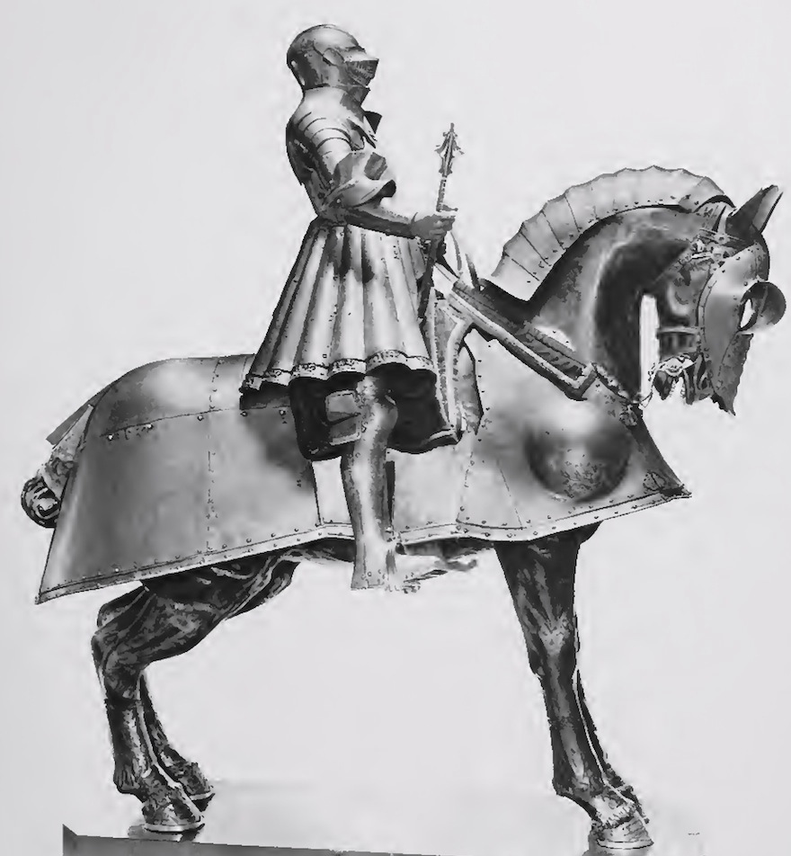image of Henry's early jousting armour stored in Tower early 20th century