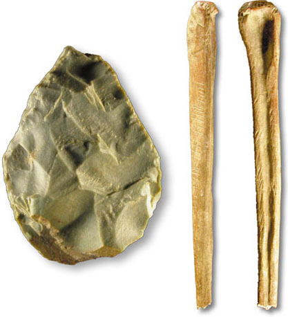 hand axe and shaped wolf bone from the site by the river Yana in North East Siberia dated to 18KYA to 29KYA